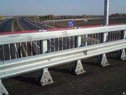 Мостовые ограждения барьерного типа 11МО